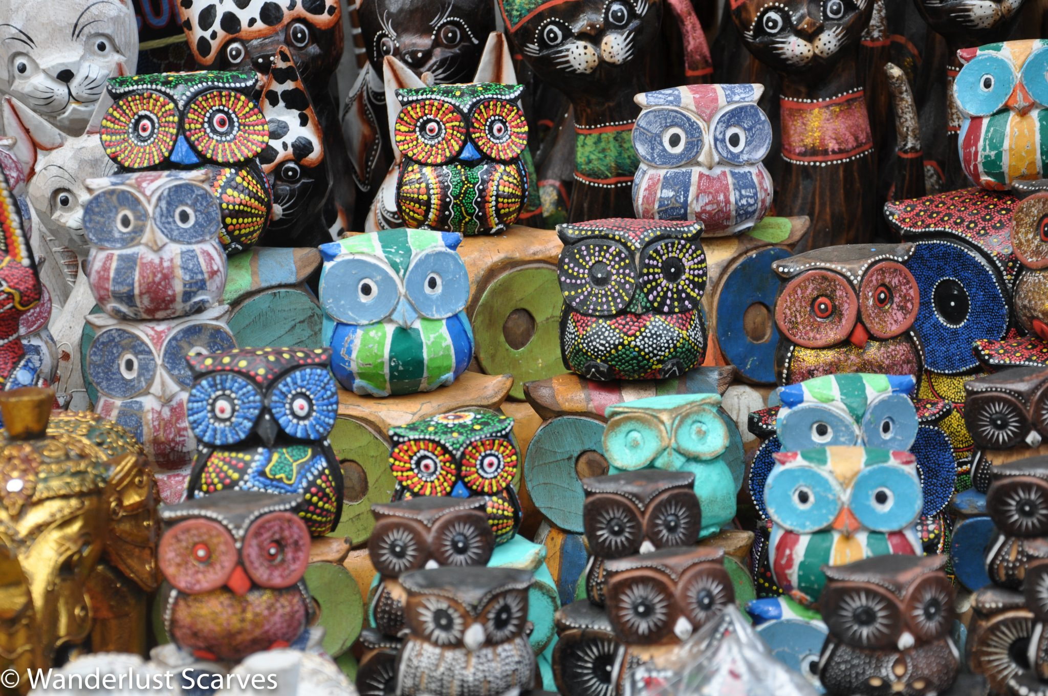 Carved Owls at the Market